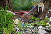 """A small """"hobbit garden"""" Bobbie Mason made for her grandchildren in Red Oak on Thursday, April 18, 2013. Mason's garden is one of the tour stops for the America Iris Society's national convention in Dallas. (Cooper Neill/The Dallas Morning News)"""