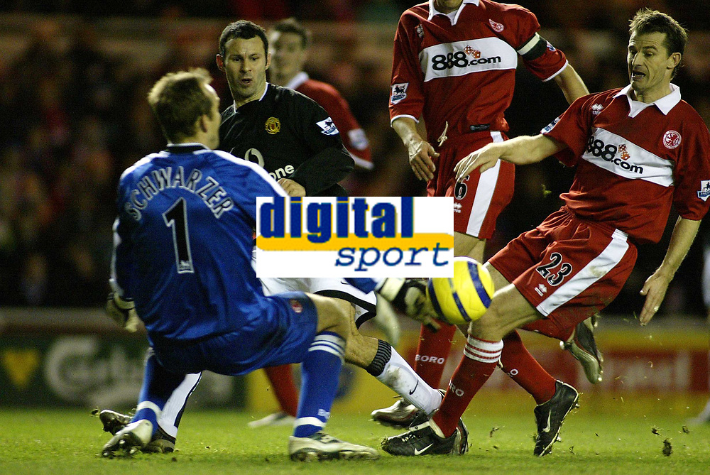The FA Barclays Premiership<br />1 January 2005, The Riverside, Stadium, Middlesbrough<br />Middlesbrough v Manchester United<br />Manchester United's Ryan Giggs scores the second goal past Middlesbrough keeper Mark Schwarzer<br />Pic Jason Cairnduff/Back Page Images