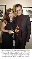 MISS SHEBAH RONAY and artist JOHNNY YEO at an exhibition in London on 20th November 2001.OUI 69