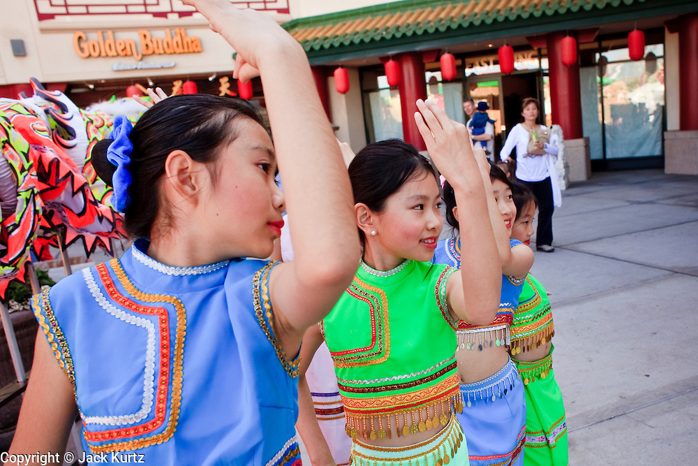 """14 FEBRUARY 2010 - PHOENIX, AZ: Girls warm up before performing at the Chinese New Year celebration in Phoenix, AZ. This marks the Chinese """"Year of the Tiger."""" The Chinese New Year Celebration at the COFCO Chinese Cultural Center in Phoenix attracted thousands of people. The celebration featured traditional Chinese entertainment and food.  PHOTO BY JACK KURTZ"""