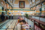 27 MARCH 2012 - HO CHI MINH CITY, VIETNAM:   People finish their mail at writing tables in the main post office in Ho Chi Minh City, Vietnam. Ho Chi Minh City, which used to be known as Saigon, is the largest city in Vietnam and the commercial hub of southern Vietnam.    PHOTO BY JACK KURTZ