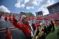 Marching band and fans cheer on the Pack during football game in Carter-Finley Stadium.