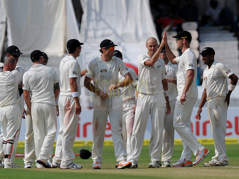 Chris Martin of New Zealand celebrate the wicket of Virat Kohli of India during day one of the first test match between India and New Zealand held at The Rajiv Gandhi International Stadium in Hyderabad, India on the 23rd August 2012..Photo by: Pal Pillai/BCCI/SPORTZPICS