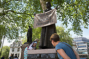 Admirers of suffragist Millicent Garrett Fawcett's statue, the first woman to appear among an all-male Parliament Square, on 9th May 2018, in London, England. Dame Millicent Garrett Fawcett GBE was a British feminist, intellectual, political leader, activist and writer. She is primarily known for her work as a campaigner for women's suffrage