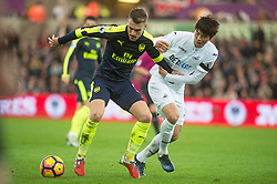 SWANSEA, WALES - Saturday, January 14, 2017: Swansea City's xxxx in action against Arsenal during the FA Premier League match at the Liberty Stadium. (Pic by Gwenno Davies/Propaganda)<br /> <br /> Arsenal's Aaron Ramsey in action against Ki Sung-Yueng of Swansea City during the FA Premier League match at the Liberty Stadium. (Pic by Gwenno Davies/Propaganda)