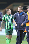 AFC Wimbledon defender & captain Barry Fuller (2) and AFC Wimbledon manager Neal Ardley during the EFL League 1 match between Peterborough United and AFC Wimbledon at ABAX Stadium, London Road, Peterborough, England on 22 October 2016. Photo by Stuart Butcher.