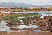 Sekururwe is small community in Limpopo. They lost most of their agricultural land in 2005 when it was leased to a platinum mine. These photographs were taken as the community fought to get further compensation from the mine. They believe they were not fully involved in the consultation process or made aware of the affects the mine would bring to the economy of the village, their way of life, their ancestral graves and underground water.<br /> <br /> As a result of negotiations initiated by the Legal Resources Centre the mine made a substantial offer for financial compensation in 2011. South African law stipulates that consent must be gained before mining on communal land yet it is unclear how and whom this consent is gained from.<br /> <br /> &copy;Zute &amp; Demelza Lightfoot / Legal Resources Centre