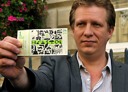 © Licensed to London News Pictures. 19/09/2012. Bristol, UK. Bristol City Councillor Guy Poultney, Cabinet Member for Communities, at the launch of the Bristol Pound, the first local currency to be implemented across a major UK city and already supported by over 300 traders, including electronic payments and supported by the Bristol Credit Union. The notes feature art by local artists and the launch was in Corn Street Bristol, the site of the historic trading area where deals were done on the nails, metal pedestals on the street.  19 September 2012..Photo credit : Simon Chapman/LNP