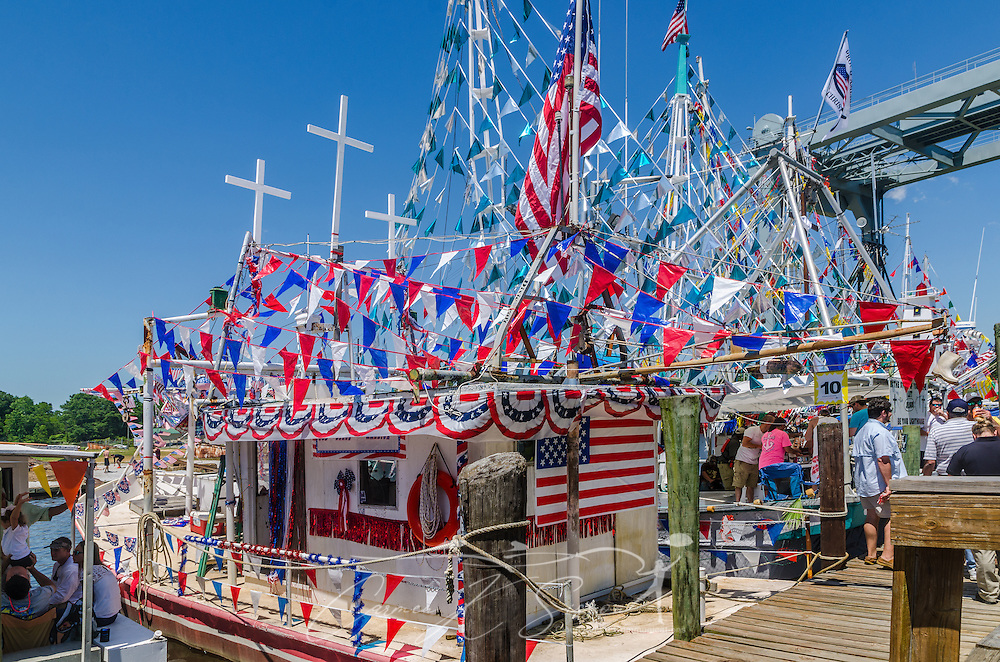 "A decorated boat, ""Why Bother,"" sits docked with other decorated boats during the 65th annual Blessing of the Fleet in Bayou La Batre, Alabama, May 4, 2014. The vessel took third place among the decorated, large commercial boats. The first fleet blessing was held by St. Margaret's Catholic Church in 1949, carrying on a long European tradition of asking God's favor for a bountiful seafood harvest and protection from the perils of the sea. The highlight of the event is a blessing of the boats by the local Catholic archbishop and the tossing of a ceremonial wreath in memory of those who have lost their lives at sea. The event also includes a land parade and a parade of decorated boats that slowly cruise through the bayou. (Photo by Carmen K. Sisson/Cloudybright)"