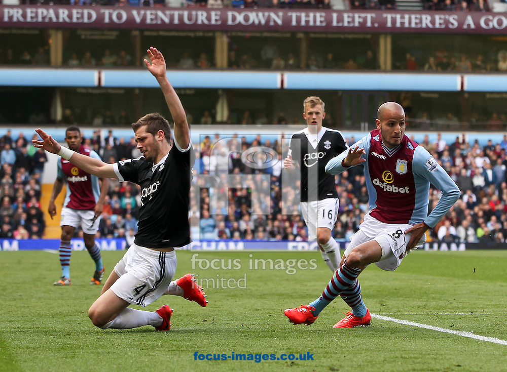 Karim El Ahmadi (right) of Aston Villa fouls Morgan Schneiderlin (left) of Southampton during the Barclays Premier League match at Villa Park, Birmingham<br /> Picture by Tom Smith/Focus Images Ltd 07545141164<br /> 19/04/2014