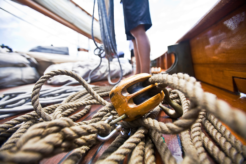 A tangle of  ropes and blocks lay on the deck of the schooner yacht SY Altair during the 2008 Antigua Classic Yacht Regatta . This race is one of the worlds most prestigious traditional yacht races. It takes place annually off the cost of Antigua in the British West Indies. Antigua is a yachting haven, historically a British navy base in the times of Nelson.