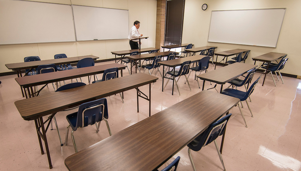 Carlos Aguilar checks out as classroom at the Gulfton Middle College High School, June 19, 2014.