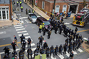 CHARLOTTESVILLE, USA - August 12: Police, medical personnel, and other protestors attend to the injured people after a car rammed into a crowd of anti-White Supremacy protestors in Charlottesville, Va., USA on August 12, 2017.