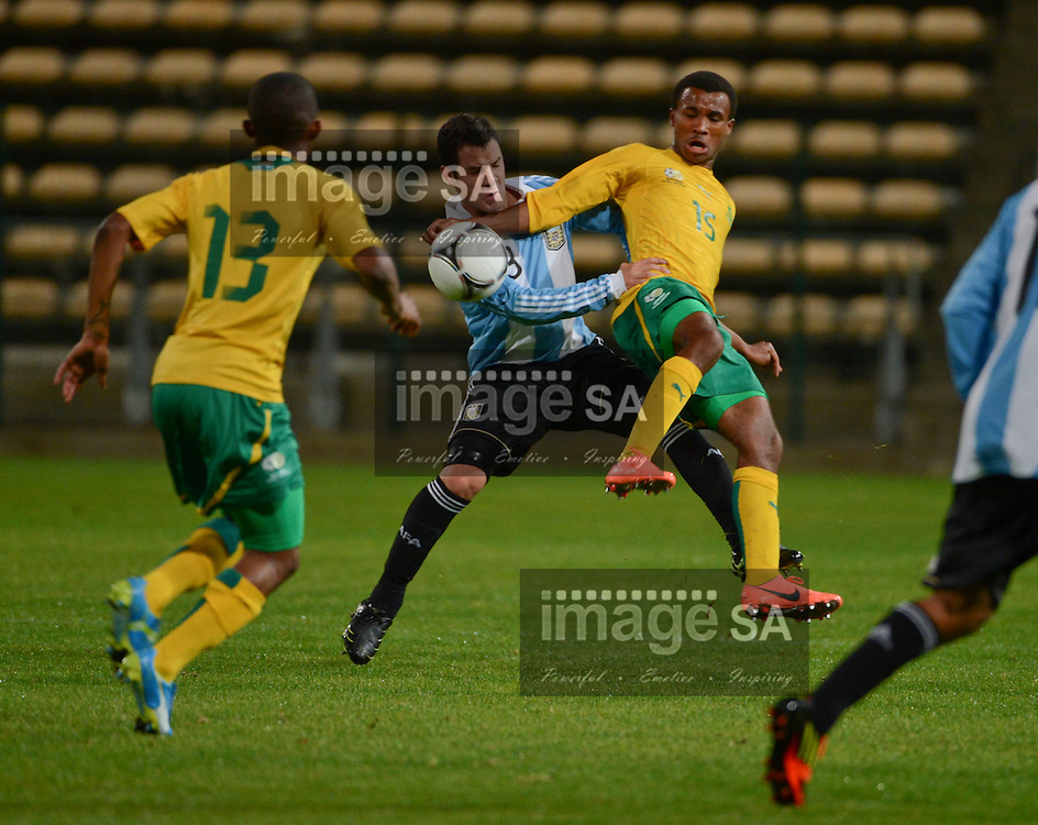 FEDERICO ANDRADA of Argentina and ASIVE LANGWE of South Africa during the 8 Nations under 20 Football Challenge soccer match between South Africa and Argentina at Athlone stadium in Cape Town, South Africa..