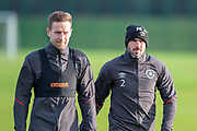 Steven MacLean (#18) of Heart of Midlothian and Michael Smith (#2) of Heart of Midlothian brave the elements during training ahead of the visit of Rangers in the Scottish Premiership on 1st December 2018, at Oriam Sports Performance Centre, Riccarton, Scotland on 30 November 2018.