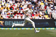 Stuart Broad runs into bowl during the Magellan fourth test match between Australia v England at  the Melbourne Cricket Ground, Melbourne, Australia on 26 December 2017. Photo by Mark  Witte.