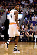 Dec 29, 2016; Phoenix, AZ, USA;  Phoenix Suns guard Brandon Knight (11) looks back up the court after a call made in the first half of the NBA game at Talking Stick Resort Arena. The Suns won 99-91. Mandatory Credit: Jennifer Stewart-USA TODAY Sports