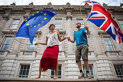 © Licensed to London News Pictures. 31/08/2019. London, UK. Two protesters wave the EU and Union Jack flags as thousands of protesters gather outside Downing Street to protest against the suspension of Parliament. The Queen has approved Prime Minister Boris Johnson's request to prorogue Parliament shortly after MPs return to work in September, a few weeks before the Brexit deadline of 31 October. Photo credit: Rob Pinney/LNP