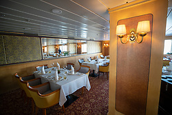 Queen's Grill restaurant interior  of Queen Elizabeth 2 former ocean liner now reopened as hotel in Dubai , United Arab Emirates