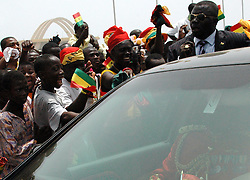 Ghana, Accra, 2007. Heads of state are accorded a rock star's welcome as Independence Day celebrations continue.