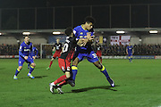 AFC Wimbledon striker Lyle Taylor (33) and Coventry City defender Dion Kelly-Evans (30) during the EFL Sky Bet League 1 match between AFC Wimbledon and Coventry City at the Cherry Red Records Stadium, Kingston, England on 14 February 2017. Photo by Stuart Butcher.