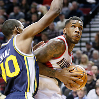 06 December 2013: Utah Jazz small forward Jeremy Evans (40) defends on Portland Trail Blazers power forward Thomas Robinson (41) during the Portland Trail Blazers 130-98 victory over the Utah Jazz at the Moda Center, Portland, Oregon, USA.