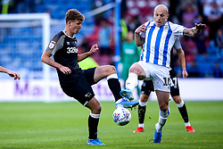Kieran Dowell of Derby County takes on Aaron Mooy of Huddersfield Town - Mandatory by-line: Robbie Stephenson/JMP - 05/08/2019 - FOOTBALL - The John Smith's Stadium - Huddersfield, England - Huddersfield Town v Derby County - Sky Bet Championship