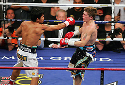 Manny Pacquiao catches Ricky Hatton with a big right hook in the first round of their Light Welterweight title fight at the MGM Grand, Las Vegas , Nevada, 2nd May 2009.