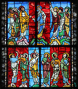 The Ascension window, with the Virgin and apostles witnessing Christ's ascension to heaven, 1136-58, stained glass window in the nave of the Cathedrale Saint-Julien du Mans or Cathedral of St Julian of Le Mans, Le Mans, Sarthe, Loire, France. The window depicting Jesus and the angels is no longer in place. The cathedral was built from the 6th to the 14th centuries, with both Romanesque and High Gothic elements. It is dedicated to St Julian of Le Mans, the city's first bishop, who established Christianity in the area in the 4th century AD. Picture by Manuel Cohen