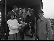 "Powers Gold Cup At Fairyhouse..1986..01.04.1986..04.01.1986..1st April 1986..""Bartres"", owned by Mr John Purfield,.won the Powers Gold Cup at Fairyhouse racecourse today.The winning jockey was Mr T Morgan and the horse was trained by Mr Des Hughes. Fairyhouse is in Co Meath near the village of Ratoath...Not an April Fools Joke, Image shows Ms Marie Cummins,Wife of Mr Michael Cummins,Managing Director,Irish Distillers Sales Company, presenting the Gold Cup to Mrs Kay Purfield(centre)..(L-R front)Ms Marie Cummins, Mrs Kay Purfield, Mr Des Hughes,Trainer..(rear) Mr Michael Cummins, Managing Director,Irish Distillers Sales Company and Mr John Purfield,owner."