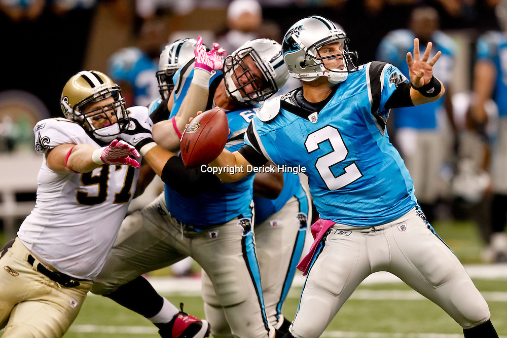 October 3, 2010; New Orleans, LA, USA; Carolina Panthers quarterback Jimmy Clausen (2) throws a pass during the fourth quarter against the New Orleans Saints at the Louisiana Superdome. The Saints defeated the Panthers 16-14. Mandatory Credit: Derick E. Hingle