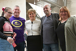 Pictured: Ms Strugeoun witn representatives of the Mental Health Support Group who are promoting recovery through the performing arts.<br /> <br /> No time to relax for Nicol;a Sturgeon after First Minister's questions at the Scottish Parliament with so many pressure groups seeking a moment of her time to press their case and grab the all important selfie.<br /> <br /> <br /> Ger Harley | EEm 23 May 2019
