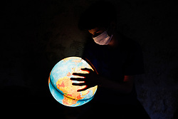 Symbolic images - Coronavirus with Child and Earth globe on may 2, 2020. Photo by Marie Hubert Psaila/ABACAPRESS.COM