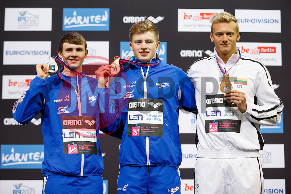 The Podium for the Mens 100m Breaststroke Final, L-R Silver, Ross Murdoch of Great Britain, Gold Adam Peaty of Great Britain and Bronze, Giedrius Titenis Of Lithuania - Photo mandatory by-line: Rogan Thomson/JMP - 07966 386802 - 19/08/2014 - SPORT - SWIMMING - Berlin, Germany - Velodrom im Europa-Sportpark - 32nd LEN European Swimming Championships 2014 - Day 7.