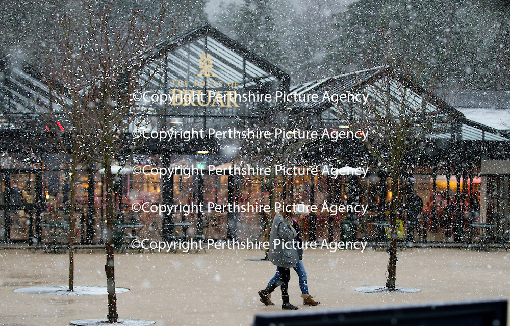 Shoppers battle the wintry weather at the House of Bruar today as the first serious snowfall of the winter hits Perthshire...07.12.14<br /> Picture by Graeme Hart.<br /> Copyright Perthshire Picture Agency<br /> Tel: 01738 623350  Mobile: 07990 594431