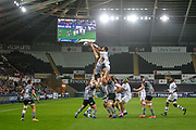 Sitaleki Timani of ASM Clermont Auvergne and Lloyd Ashley of Ospreys contest foe the lineout during the European Rugby Challenge Cup match between Ospreys and ASM Clermont Auvergne at The Liberty Stadium, Swansea on 15 October 2017. Photo by Andrew Lewis.