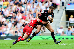 Ollie Devoto of Exeter Chiefs is tackled by Alex Lozowski of Saracens - Mandatory by-line: Ryan Hiscott/JMP - 01/06/2019 - RUGBY - Twickenham Stadium - London, England - Exeter Chiefs v Saracens - Gallagher Premiership Rugby Final