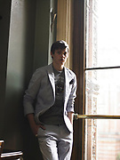 Teenager Standing By Window