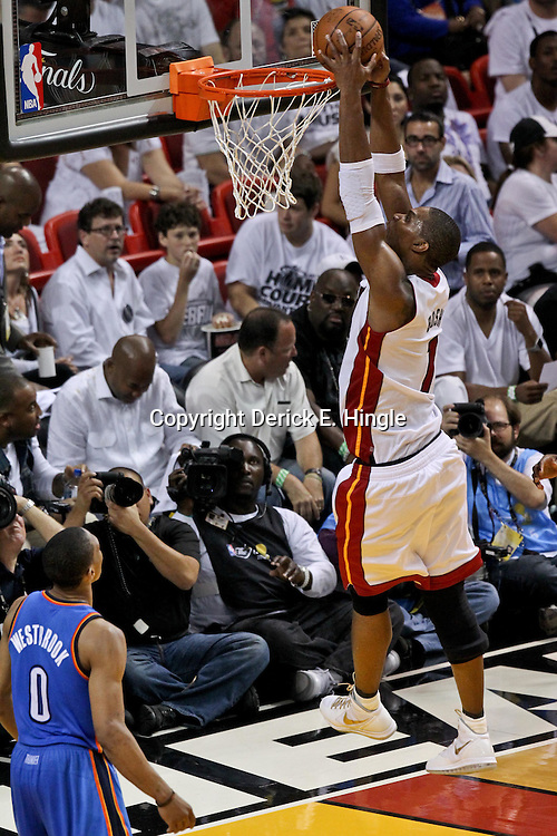 Jun 21, 2012; Miami, FL, USA; Miami Heat power forward Chris Bosh (1) dunks against the Oklahoma City Thunder during the third quarter in game five in the 2012 NBA Finals at the American Airlines Arena. Mandatory Credit: Derick E. Hingle-US PRESSWIRE
