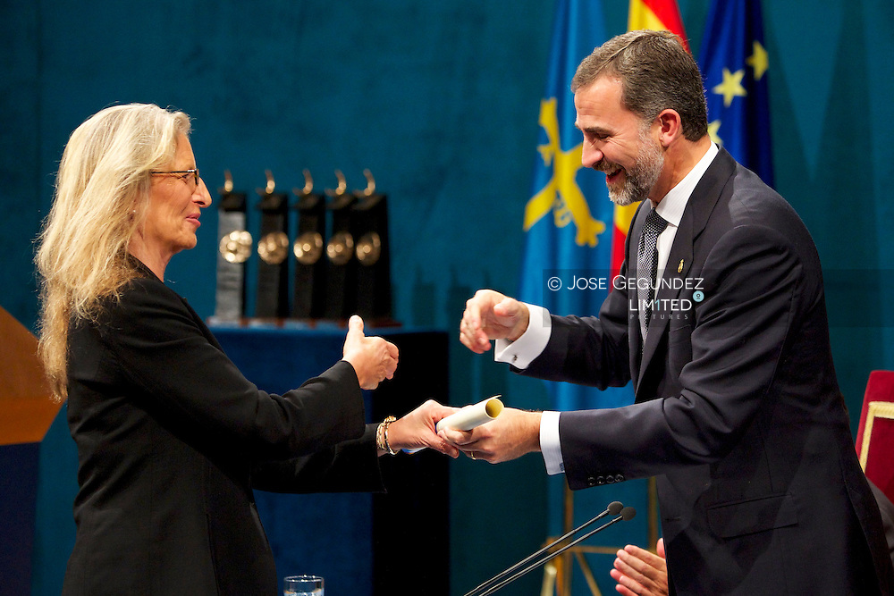 Prince Felipe of Spain delivery 'Prince of Asturias Awards 2013' to Annie Leibovitz during ceremony Gala at the Campoamor Theater on October 25, 2013 in Oviedo, Spain.