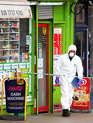 © under license to London News Pictures. 26/03/12 Three found men have been found guilty of GBH with intent relating to 5-year-old Thusha Kamaleswaran who was paralysed in Stockwell shooting. FILE PICTURE DATED 30/03/2011.  Police forensic officers investigate the Stockwell Food & Wine shop, Stockwell Road, Brixton where a 5 year old girl and a 35 year old man were shot last night. . Photo credit should read Cliff Hide/LNP