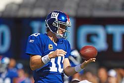 Oct 16, 2011; East Rutherford, NJ, USA; New York Giants quarterback Eli Manning (10) warms up before the game against the Buffalo Bills at MetLife Stadium. New York defeated Buffalo 27-24. Mandatory Credit: Jason O. Watson-US PRESSWIRE