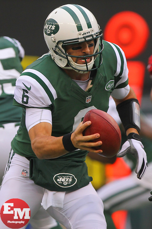 Dec 2, 2012; East Rutherford, NJ, USA; New York Jets quarterback Mark Sanchez (6) fakes a handoff during the first half of their game against the Arizona Cardinals at MetLIfe Stadium.