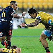 Ben Lam  prepares to tackled Tevita Li during the super rugby union  game between Hurricanes  and Highlanders, played at Westpac Stadium, Wellington, New Zealand on 24 March 2018.  Hurricanes won 29-12.