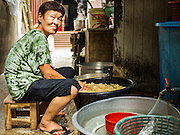 03 AUGUST 2016 - BANGKOK, THAILAND: A woman who lives in the Pom Mahakan slum prepares a meal in her outdoor kitchen. Outdoor kitchens are common in Thailand, even in Bangkok. Residents of the slum have been told they must leave the fort and that their community will be torn down. The community is known for fireworks, fighting cocks and bird cages. Mahakan Fort was built in 1783 during the reign of Siamese King Rama I. It was one of 14 fortresses designed to protect Bangkok from foreign invaders. Only of two are remaining, the others have been torn down. A community developed in the fort when people started building houses and moving into it during the reign of King Rama V (1868-1910). The land was expropriated by Bangkok city government in 1992, but the people living in the fort refused to move. In 2004 courts ruled against the residents and said the city could take the land. Eviction notices have been posted in the community and people given until April 30 to leave, but most residents have refused to move. Residents think Bangkok city officials will start evictions around August 15, but there has not been any official word from the city.      PHOTO BY JACK KURTZ