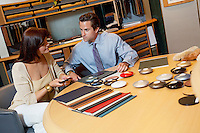 Salesperson showing color samples to female client