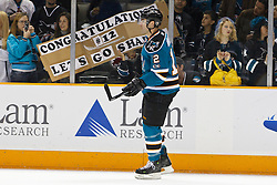 January 22, 2011; San Jose, CA, USA; San Jose Sharks center Patrick Marleau (12) skates by fans holding up a banner for him before the game against the Minnesota Wild at HP Pavilion. Mandatory Credit: Jason O. Watson / US PRESSWIRE