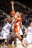 Idaho State guard Jeni Boesel (5) drives the lane against pressure from Kansas State's Jessica McFarland (50) during the first half at Bramlage Coliseum in Manhattan, Kansas, March 17, 2006.  K-State leads the Bengals at half-time 44-27.