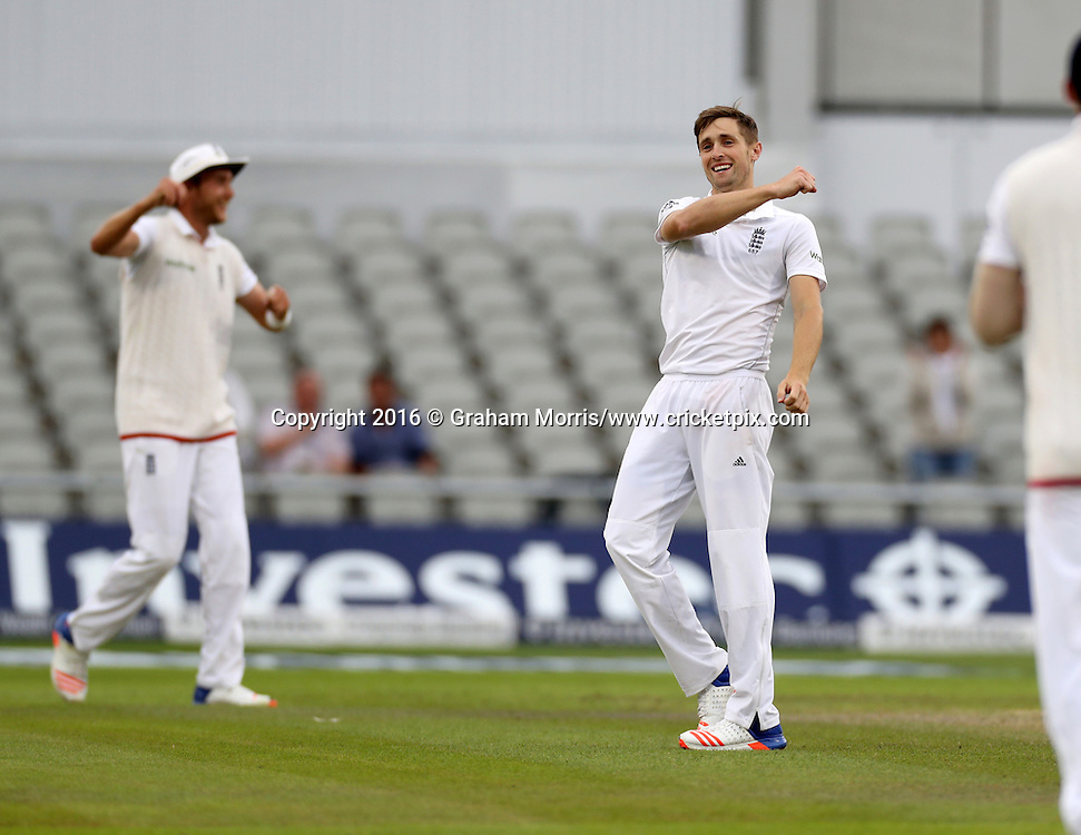 Bowler Chris Woakes celebrates the win after Mohammad Amir is caught by Stuart Broad (left) during the second Investec Test Match between England and Pakistan at Old Trafford, Manchester. Photo: Graham Morris/www.cricketpix.com 25/7/16
