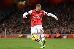 Arsenal's Kieran Gibbs crosses the ball - Photo mandatory by-line: Mitchell Gunn/JMP - Tel: Mobile: 07966 386802 23/11/2013 - SPORT - Football - London - Emirates Stadium - Arsenal v Southampton - Barclays Premier League